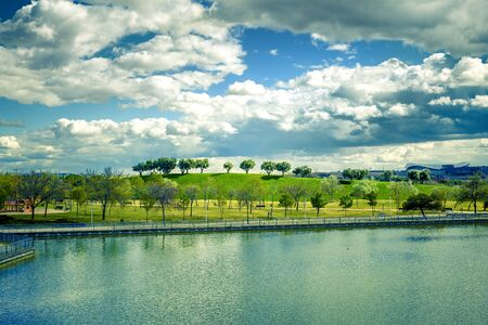 landscape of green park wiht  a lake in Madrid city