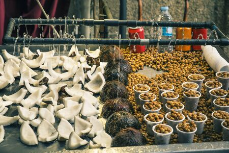 close up of fruit in food stall with coconuts and chufas outdoors