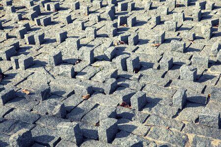 small granite blocks superimposed vertically and horizontally