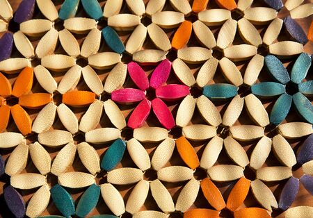 multicolor floral pattern with wooden petals illuminated by sunlight