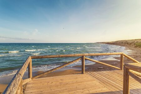 sea views from a wooden balcony overlooking the beach