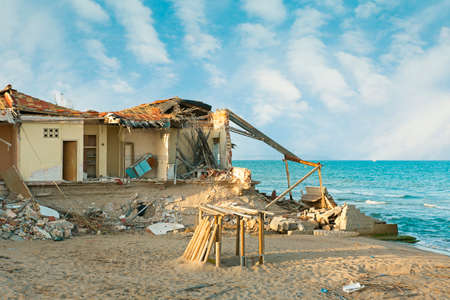 Building destroyed after storm in the beach by climate change Reklamní fotografie