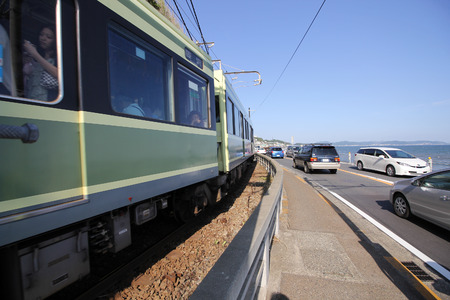 railway history: KAMAKURA, JAPAN - June 4: Enoden Line in Kamakura, Japan on June 4, 2015. Enoshima Electric Railway, has 100 years of history, links the central Shonan area,
