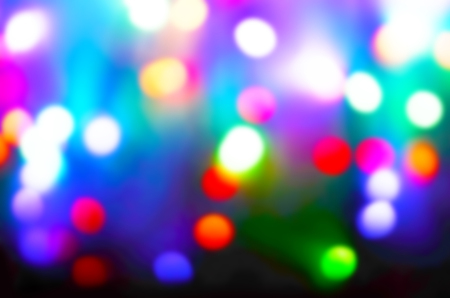 Abstract festive background bokeh. Bright colored blurry lights.