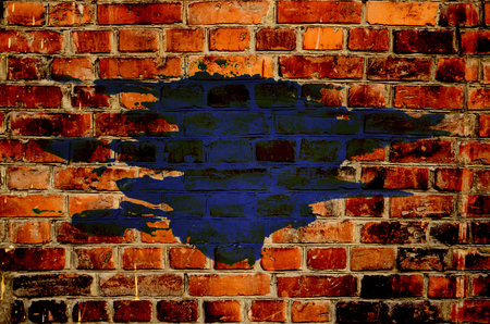 A blue stain on the wall of red brick. Abstract background. Grunge texture. Place for text