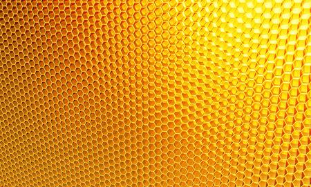 Macro, honeycomb. Background of orange, yellow hexagons Stock Photo