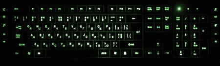 The keyboard is backlit completely, completely. Color green.
