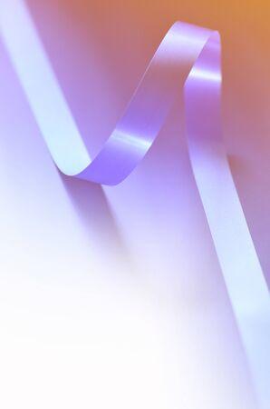 Cover. Shiny satin ribbon in lilac, orange on white color. Ribbon image for decoration design.