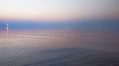Background of sky and sea concept: Dramatic sunrise on sea. Banco de Imagens