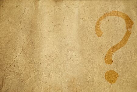 Background. Question mark painted on a yellow wall. Light brown. Place for text