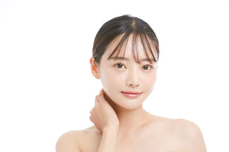Beauty portrait of a young Asian woman with a white background
