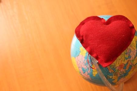 Earth under heart Stock Photo