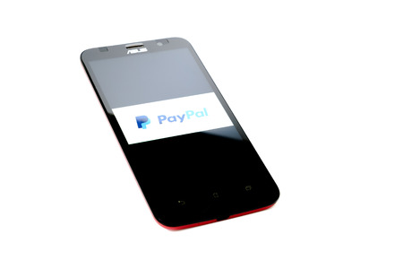 paypal: KUALA LUMPUR - OCTOBER 25,2015. PayPal payment system logo on smartphone.