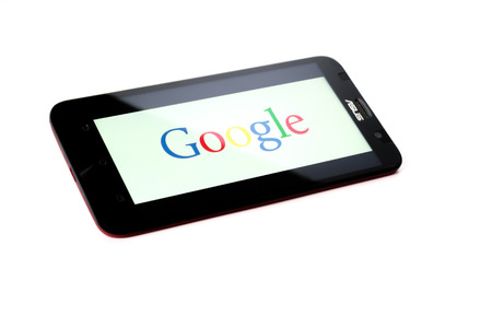 google chrome: KUALA LUMPUR - OCTOBER 2,2015. Google logo on smartphone. Google Inc. is an American multinational technology company specializing in Internet-related services and products. Editorial