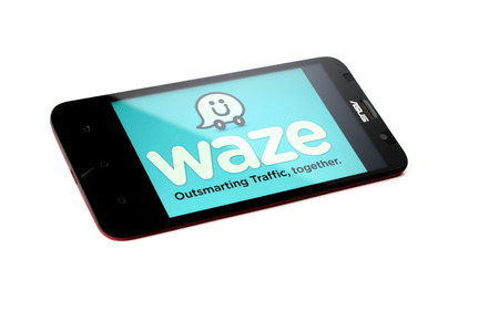 acquired: KUALA LUMPUR - OCTOBER 25, 2015. Waze a popular community based and navigation smartphone app developed in Israel, and was acquired by Google in 2013.