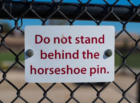 Horseshoe Warning Sign
