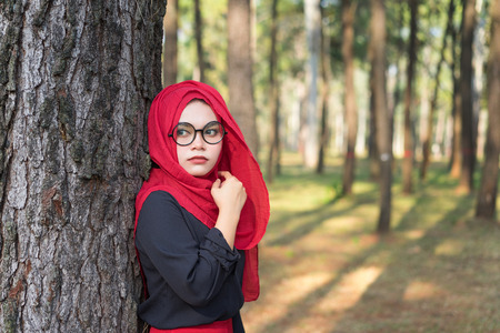 Fashion portrait of young beautiful muslim woman with the red  hijab