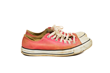 Side angle view of The old red sneakers with clipping path, isolated on a white background Stock Photo