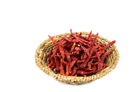 hottest: Dried chillies in the basket with clipping path, isolated on white background. Stock Photo
