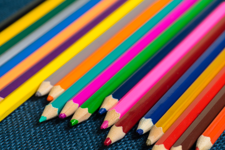 Close up view of crayons. Colored Pencils. Colored pencils on wooden background. School and education. Art and design. Bunch of the pencicls. Drawing and painting. Stock Photo