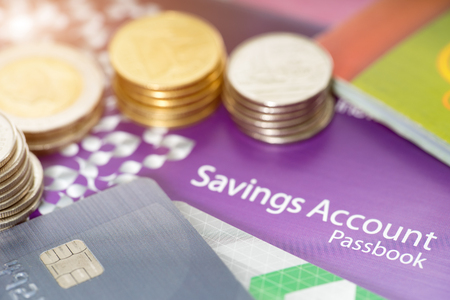 Financial concept,saving account passbooks,credit card and coin. Stock Photo