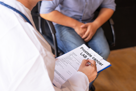 Male doctor and prostate cancer patient are discussing about prostate cancer test report. Diagnostic, prevention of men diseases, healthcare, medical service, consultation, healthy lifestyle concept. Stock Photo
