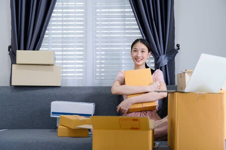 Attractive asian teenage start up running small business owner from home office. Home business concept Zdjęcie Seryjne