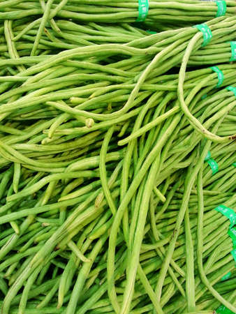 long beans: Long beans being sold in a market.