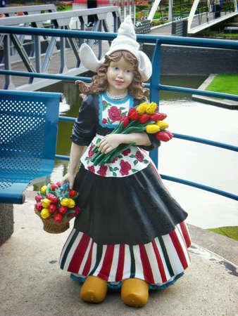 dutch girl: A statue of a Dutch girl carrying tulips.