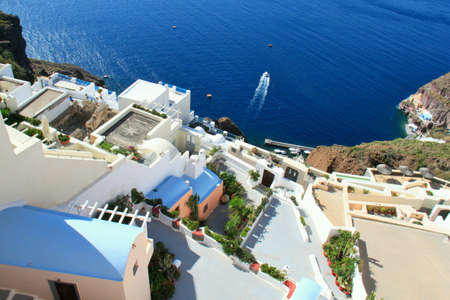 santorini greece: Cliff houses overlooking blue sea Santorini Greece.