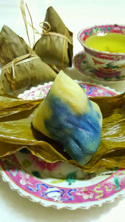 malaysia culture: Peranakan Dumpling Served with Green Tea Stock Photo