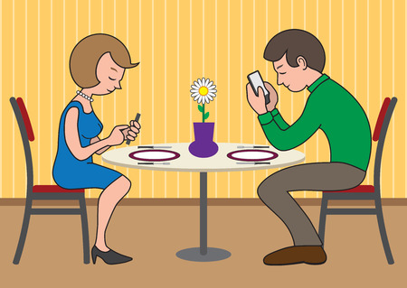 strangers: Contemporary couple on a date more interested in their electronic devices than each other