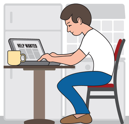Young man on laptop at kitchen table seeking employment