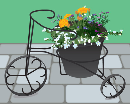 planter: Flowers in a decorative wrought iron planter
