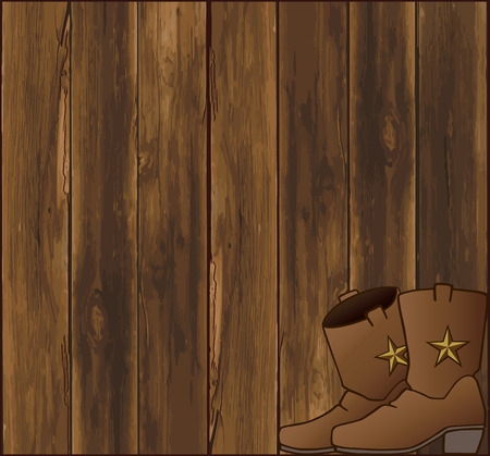 barn boots: A pair of cowboy boots resting in front of a weathered barn wall