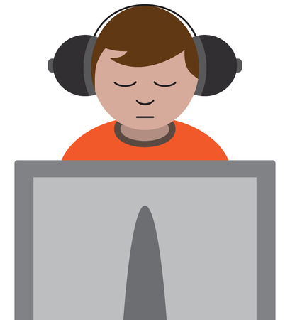 Young man is using computer while listening to headphones