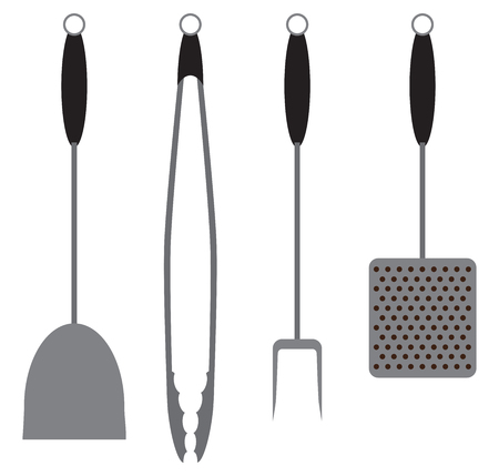 A set of barbecue tools including a spatula, tongs, fork and brush.