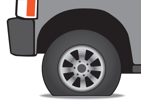 A vehicle has a flat tire that needs inflating