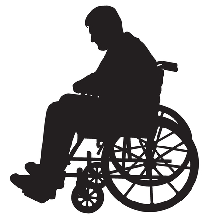 Silhouette of a man in a wheelchair depressed by his situation