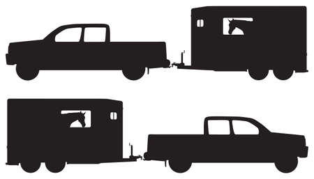 A pickup is attached to a loaded horse trailer in silhouette