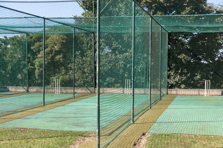 A close up view of a grass practice cricket nets