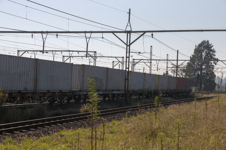 A close up view of lots of containers on the transportation train waiting for the engen to take them to the next destination