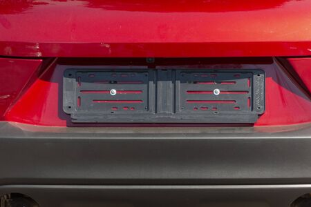 A close up view of the plastic cover on a new car that holds the licence plate on the vehicle Stockfoto