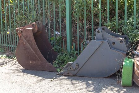 A close up view of two rusted old metal tractor arms