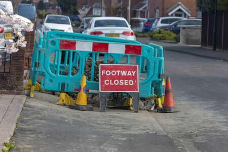 Bristol-March 2020-England-a close up view of a warning sign to say the footway was closed due to renervations and road workers  Stockfoto