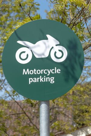 a sigh that shows a motocycle parking only  版權商用圖片