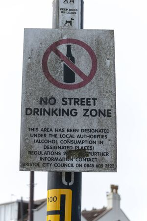 Bristol-May-2020-England-a close up view of a no street drinking zone sign on the main street