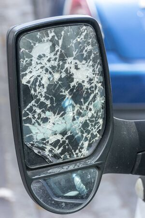 a close up view of a trucks side mirror that has been smashed