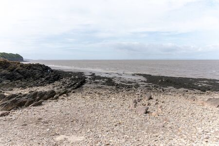 Bristol-May-2020-England-the view of the river and sea in clevedon with the rocks and thick mud leading to the waters edge