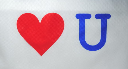overt: A red heart with the letter u.